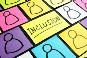 Inclusion sign and post-its with figures of people.