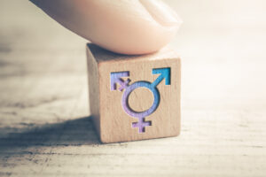 Finger resting on a wood block featuring Transgender, LGBT or Intersex Icons