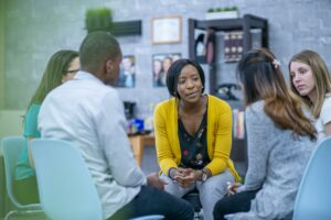 Social worker working with diverse group of clients